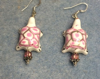 Pink and white porcelain turtle bead dangle earrings adorned with pink Czech glass beads.