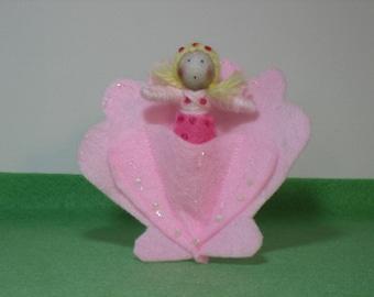 Tiny mermaid in a felt shell bed