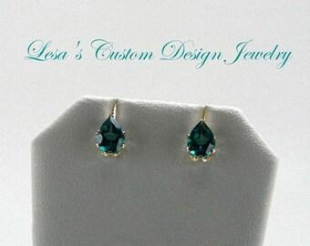4.40ctw Pear Shaped Green Topaz 14kt yellow gold stud earrings