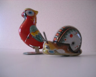 """Tin Toy Parrot and Snail  Japan and China  1940"""" /1950's  Tin wind-up toys"""