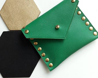 Wallet made of raw green leather and brass studs