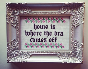 Home is where the bra comes off. Finished and framed cross stitch.