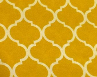 Quatrefoil fabric in gold