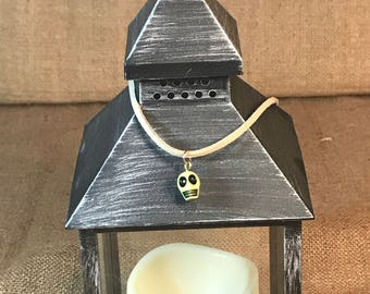 Brown-suede-choker-with-green-skull-pendant
