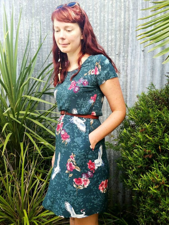 The Ziggy loose fit tunic dress with pockets in green floral cranes print