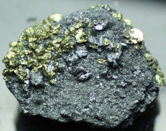 Golden Chalcopyrite crystals atop black Bournonite crystals, China  Mineral Specimen for Sale