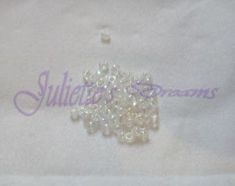 10 gr - 2x2mm hole 1 mm iridescent white seed beads.