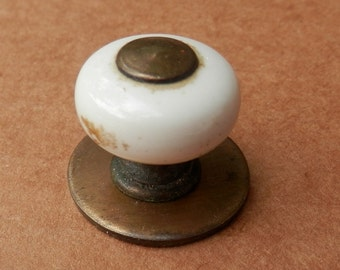 vintage porcelain knob with ant brass centers and rosette