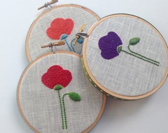 "Poppy by mlmxoxo.  hand embroidered flower. red. purple. orange. aqua.  magenta.  nature lover's gift, housewarming.  4"" embroidery hoop art"