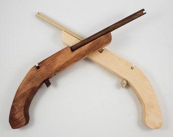 rubber band,rubber band gun,elastic gun,rubber band shooter,rubber band launcher,elastic shooter,toy rubber band gun,elastic band shooter
