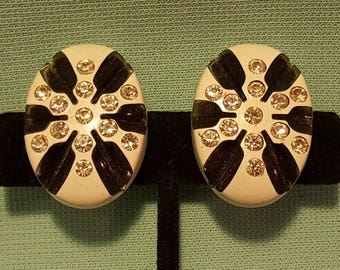 Great, vintage 50's, molded celluloid, clip earrings with rhinestones!