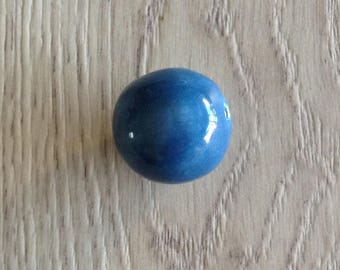 Blue ceramic bead shaped by hand