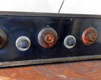 antique 1920's battery powered radio with tubes and dials and mechanics just right for the steam punk decor with ant and wicked lever switch