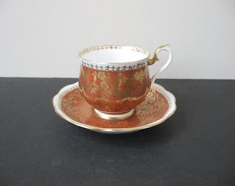 Vtg ROYAL ALBERT Bone China MARLBOROUGH Series Rust Gold Flowers Teacup & Saucer Set