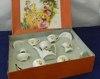 Old dolls tableware coffee set made from porcelain. Rose decoration and gold rim. 12-piece porcelain service. Probably 70s. VINTAGE