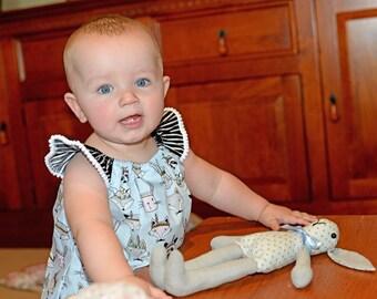 Baby girl or toddler fun animal print Seaside romper size one