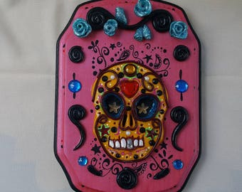 Yellow, day of the dead sugar skull, on a black and red, 5x7 inch, basswood wall plaque.