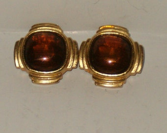 Vintage Gold Tone Textured  Clip On Earrings With A Brown Glass Center Stone