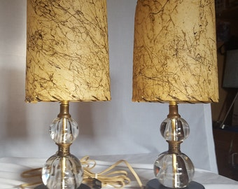 Pair of Mid Century, glass, bedside table lamps with fiberglass shades.