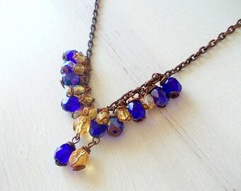 Blue and yellow necklace with glass beads, burnished chain combined with colored glass beads and pendants, trendy and elegant gift idea.