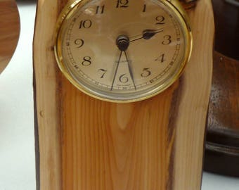 A Brass Clock set in a Beautiful,  Sliced Branch of Yew;