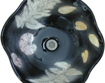 Midnite Vessel Sink with autumn colored impressed real leaf designs.