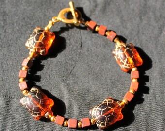 Crystal Turtles and Brown Stone Cubes Bracelet