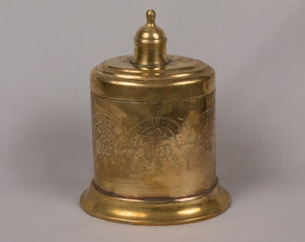 Brass oval box, Hinged, Engraved with Flowers, Leaves, Arches, Deep curved foot at the bottom, Made in India Coppery gold, Interesting piece