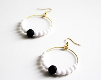 Hoop earrings with black and white beads