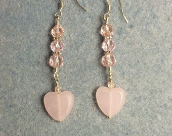 Pink glass heart bead dangle earrings adorned with pink Czech glass beads.
