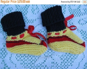 ON SALE Beautiful Yellow and Blue and Red Christmas Socks Hand Knitted for a Baby Boy or Girl.