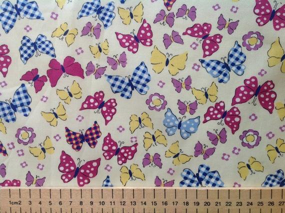 High quality cotton poplin, butterflies on light yellow or cream