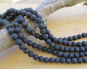 Set of 10 10 mm natural black lava round beads.