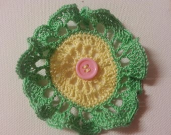 crochet flower in yellow and green cotton