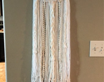 White on white braided wall hanging