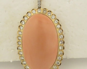 Vintage Monumental Rare 18 kt Gold Natural Medium Pink Angel Skin Coral & Diamond in Bead Set Gold Frame, Pendant.
