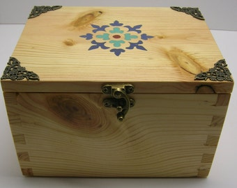 Small dovetailed box with flower inlay