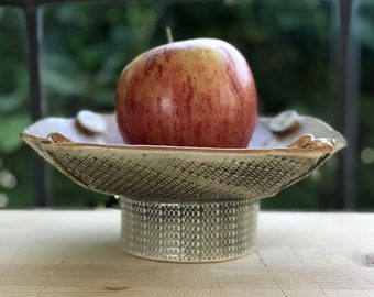 Small Shallow Handbuilt Bowl with Patterned Apricot inside and Tree Bark Dark Greenish Brown Texture Outside