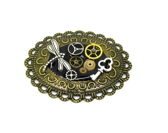 Pendant lace steampunk dragonfly, key, workings of watch