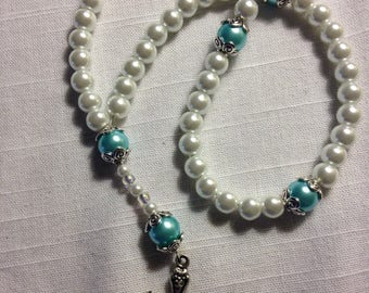 Glass prayer beads with blue accents