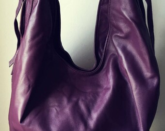Slouchy,casual soft leather bag. Two toned and easy to open this handbag holds everything.Customise it to make it your own.Free Shipping bag