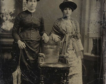 1/6 Plate Tintype Portrait of Two Fashionable Women, Maybe Sisters, in Fancy Dresses Standing by an Empty Chair