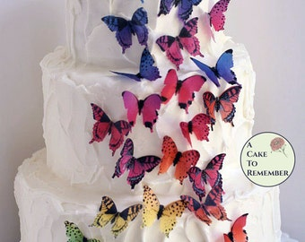 "28 rainbow edible butterflies for cake and cupcake toppers 1.5"" wafer paper butterflies. Enchanted garden birthday, butterfly wedding cakes."