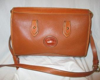 Dooney & Bourke all weather leather cross body bag