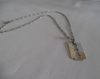 Men necklace, pendant on chain razor blade all stainless steel.