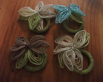 4 BEADED NAPKIN RINGS, beaded flower, glass beads