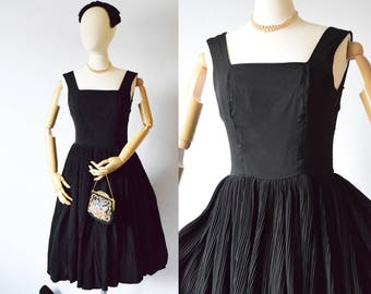 1950's Black Swing Dress with Accordion Skirt | Suzy Perette