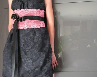 Woman black dress and lace obi belt in coral.3411