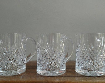Set of three decorative glass mugs