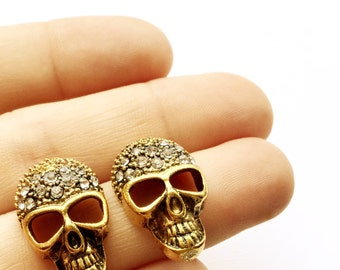 Reina Skull & Rhinestone Studs. Available in Antiqued Brass or Antiqued Silver. Fast FREE Shipping For Domestic Orders.